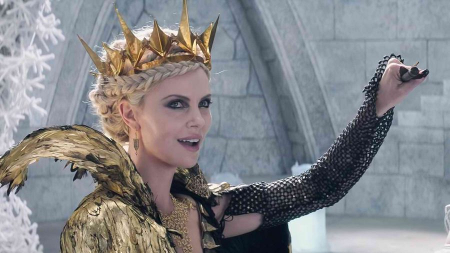Charlize Theron, reprising her role as Ravenna, smirks as she catches a bolt.
