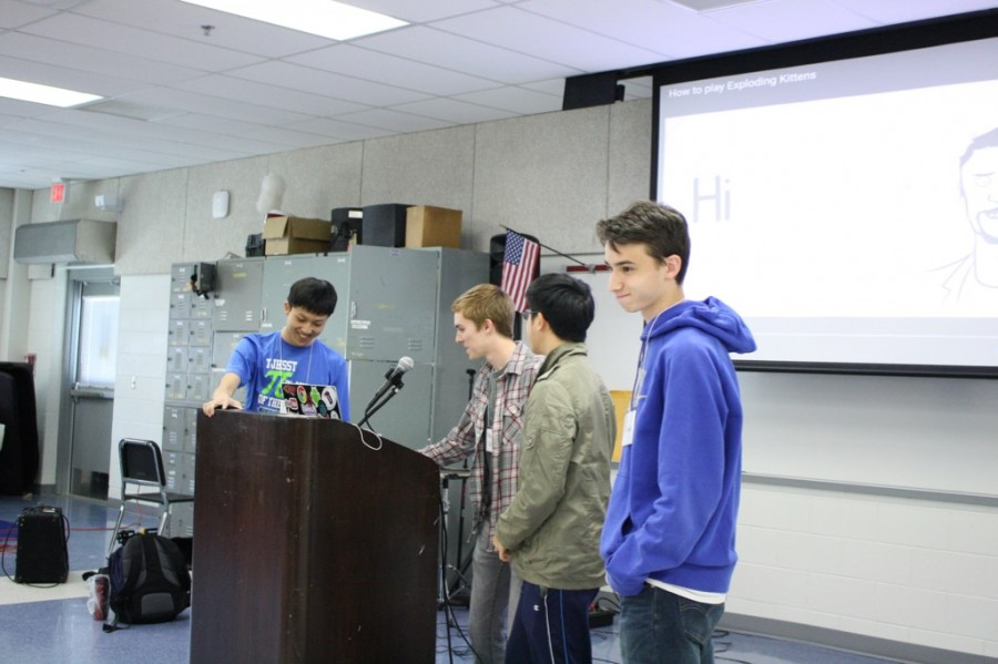 """Jeffrey Liu, Nate Foss, Aaron Ho and Eli Lifland give a presentation on card game """"Exploding Kittens"""" for Flow Day. Attendees then had a chance to play the game."""