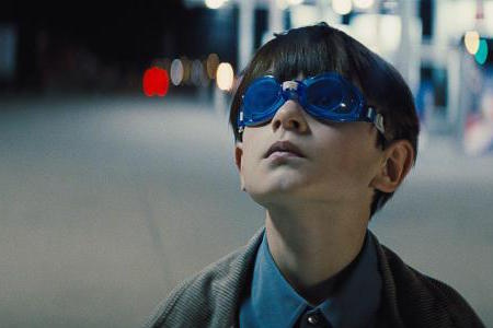 """Alton (Jaeden Lieberher) looks up at the sky, presumably using his abilities to detect technology used to track him. """"Midnight Special"""" saw its limited release on March 18, after debuting in the U.S. at South by Southwest Film Festival on March 12."""