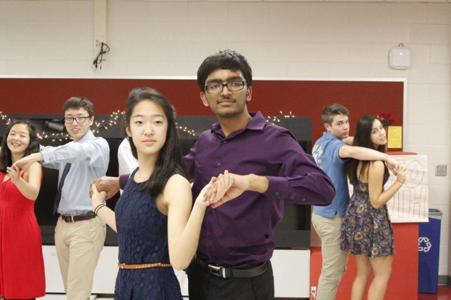 Sophomores Jainam Modh and Hannah Han hold a pose, as instructed by the dance teacher.