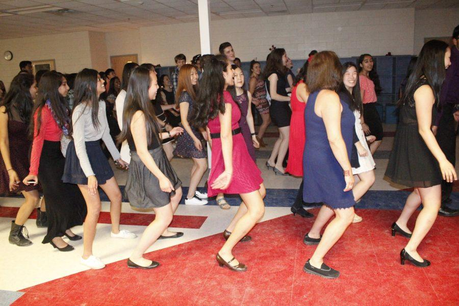 Students, joined by Señora Nannette Mateo, dance to the popular song Wobble Baby by V.I.C. at the end of Bulería.
