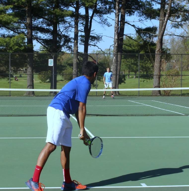 Leaning+forward%2C+senior+Nikhil+Ramachandran+prepares+to+start+the+point+in+his+singles+match+against+Marshall+High+School+at+Jefferson+District+Park.