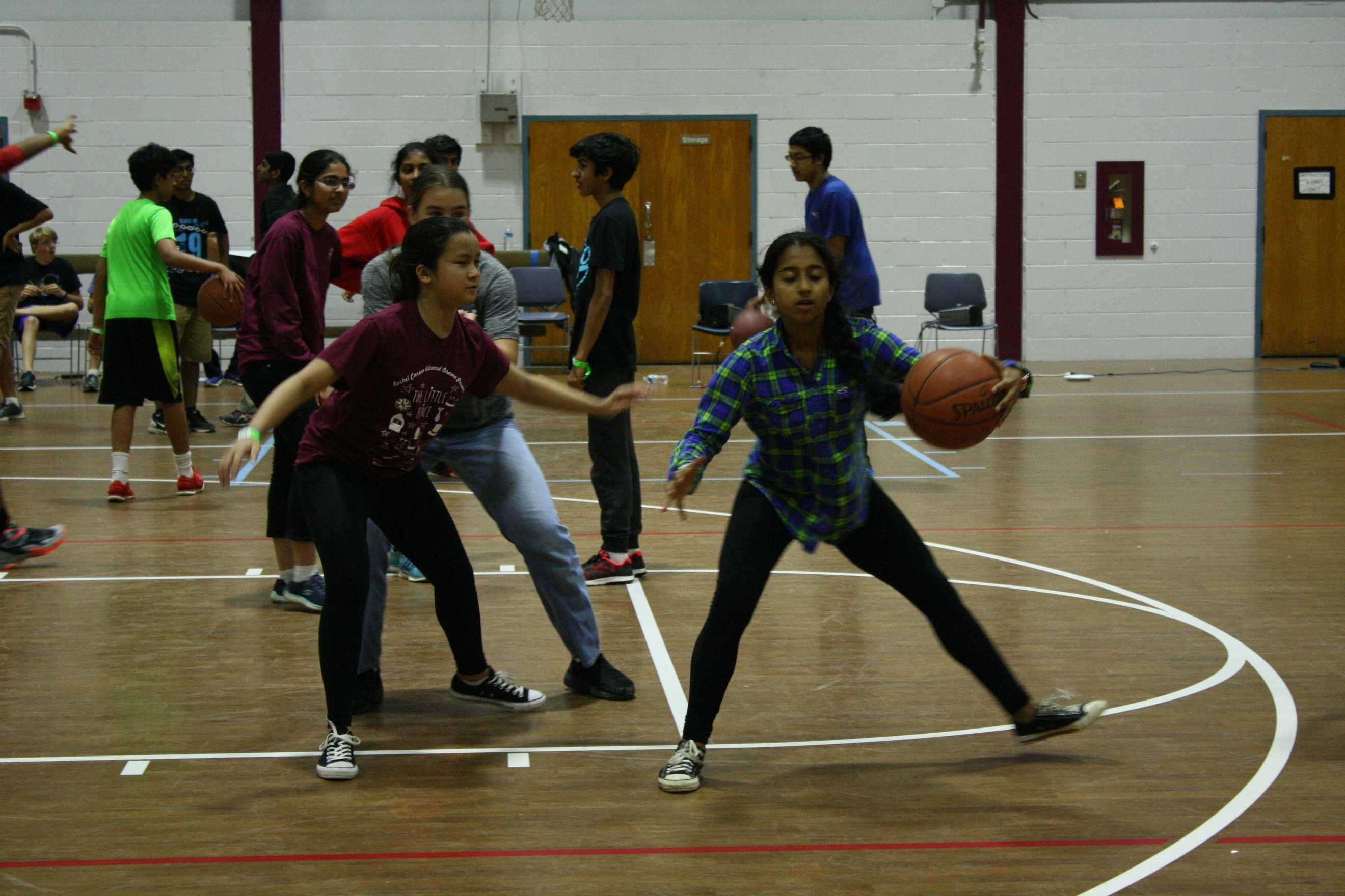 Cassidy+Trinh+and+Shambhavi+Ramaswamy+play+basketball+before+the+talent+show+during+open+gym.+Multiple+basketball+games+occurred+in+the+gym+before+the+talent+show.