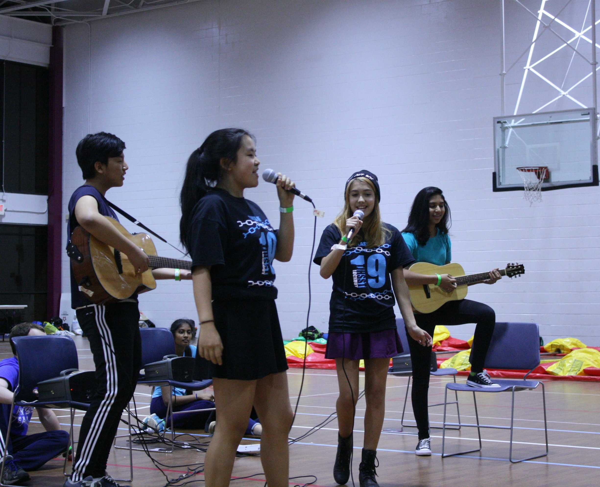 Will+Cho%2C+Reena+Medavarapu%2C+Sophia+Wang+and+Julia+Martinez+sing+Let%27s+Go+Crazy+by+One+Direction.