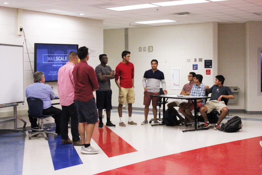 A group of four juniors prepares to present their idea, Mail Scale, to a panel of judges during the event VentureTJ, which was hosted by the different business clubs at TJ. VentureTJ is one of FBLA's biggest events apart from Marketplace, which takes place earlier on in the school year.