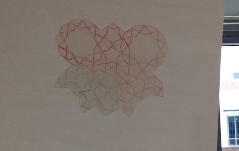 Students who attended the special Muslim Student Association event designed girih tiles and traced them onto larger sheets of paper.  Girih tiles are a set of tiles that create geometric patterns and are used commonly in Islamic architecture.