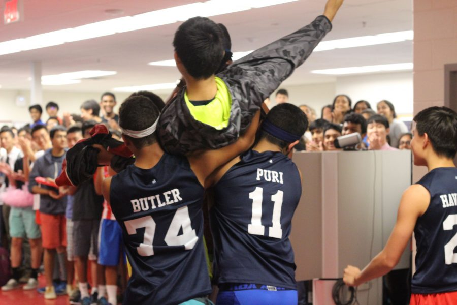 Sophomores Scott Becker, Andrew Butler, Sid Muralidhar, Anthony Thomas, and Joshua Havermale hoist Nathan Chen onto their shoulders and parade him around the commons.