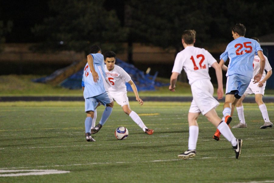 Sophomore Thomas Baron looks at junior Jack Schefer before passing to him.