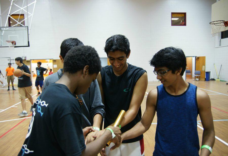Maxwell Jones, Aditya Koneru, and Nikhil Bandaru get ready for the relay races.