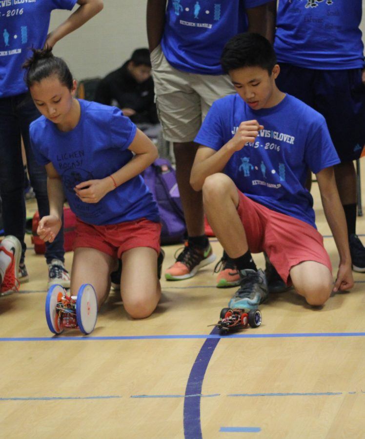Alice Fontaine and Lance Nguyen watch their robots race.