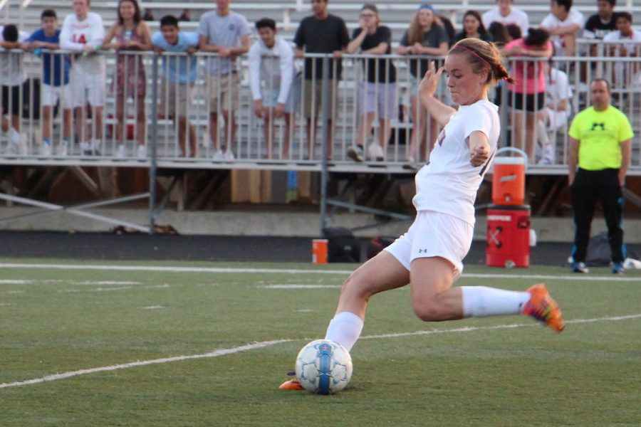 Senior Maaike Blindenbach kicks the ball during the girls varsity soccer game against Potomac Falls on May 24.