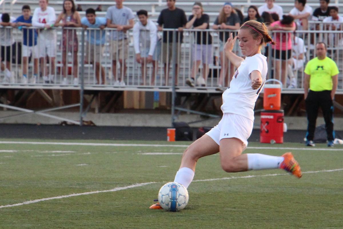 Senior Maaike Blindenbach kicks the ball during the girls varsity soccer game against Potomac Falls on May 24.