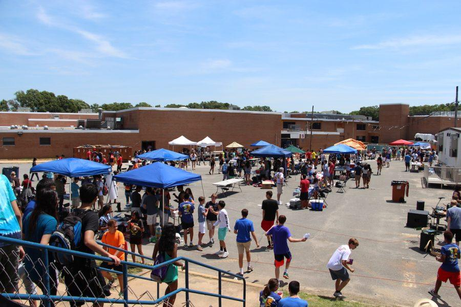 Students walk around the club booths during J-Day on June 10.