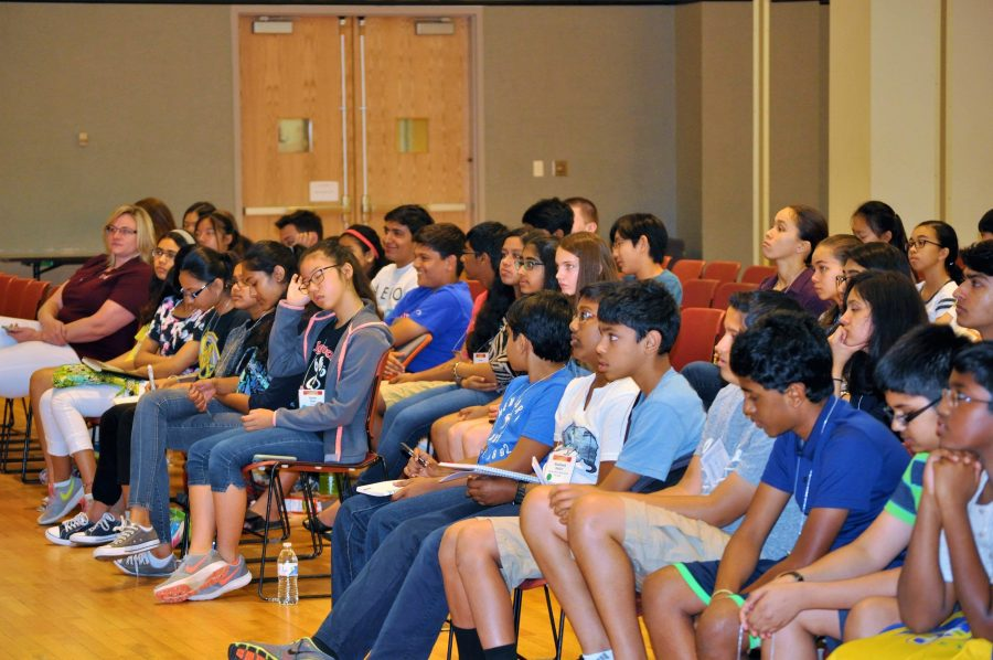 A group of middle school students listen to Prathik Naidu's keynote speech at the beginning of the conference. Photo courtesy of Prathik Naidu.