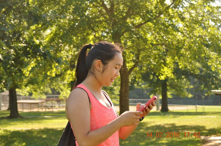 Rising sophomore Anne Nguyen travels in the park in search for more Pokémon