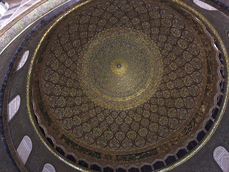 An+inside+view+of+the+Dome+of+the+Rock.+The+walls+are+covered+with+intricate+geometric+designs+and+Arabic+calligraphy.+