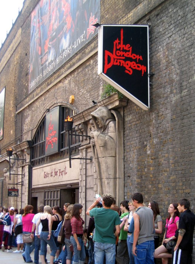 Tourists wait in line for an opportunity to experience the London Dungeon.