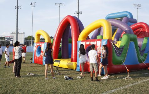 Students gather around the bounce house at the Back to School Bash, held on Sept. 9.