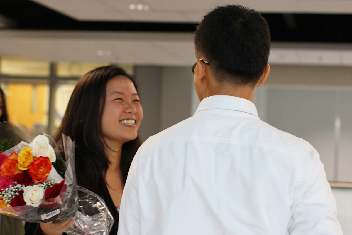 Senior Laura Chu accepts senior Justin Lee's homecoming asking.