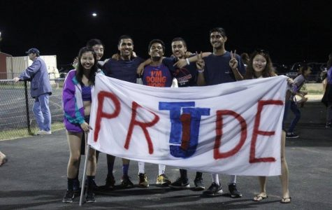 Seniors Patty Vitsupakorn, Daniel Chen, Kanishkha Gaba, Advait Kulkarni, Rohan Taneja, Nakul Dar, and Jenny Kim show their spirit with a banner to support the team.