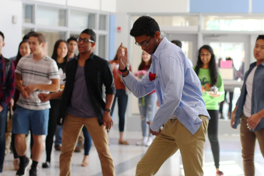 Junior Ishaan Dey performs a dance before asking sophomore Pari Parajuli to homecoming.