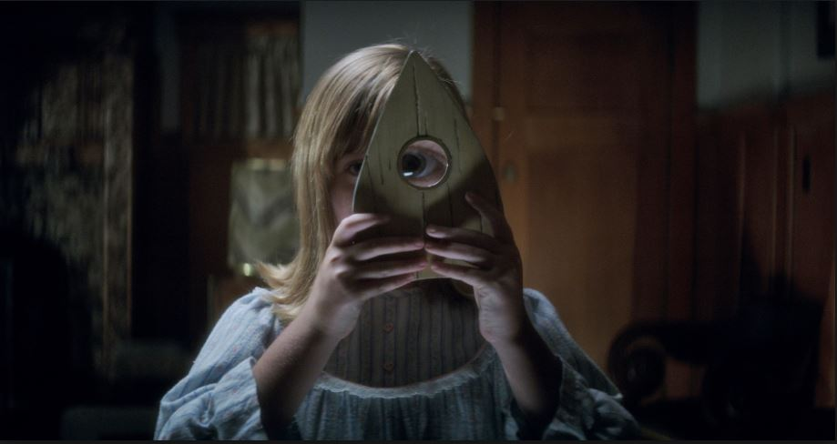 Photo courtesy of Universal Pictures. In this scene of the movie, Doris uses the planchette to try and see any spirit that may be trying to contact her through the Ouija board.
