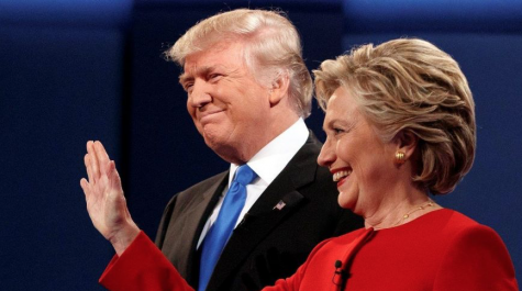 Hillary Clinton and Donald Trump stand together before beginning the first televised Presidential Debate of the 2016 campaign.