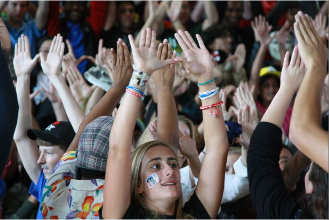 Senior Dana Scheetz raises her hands to show her class spirit.
