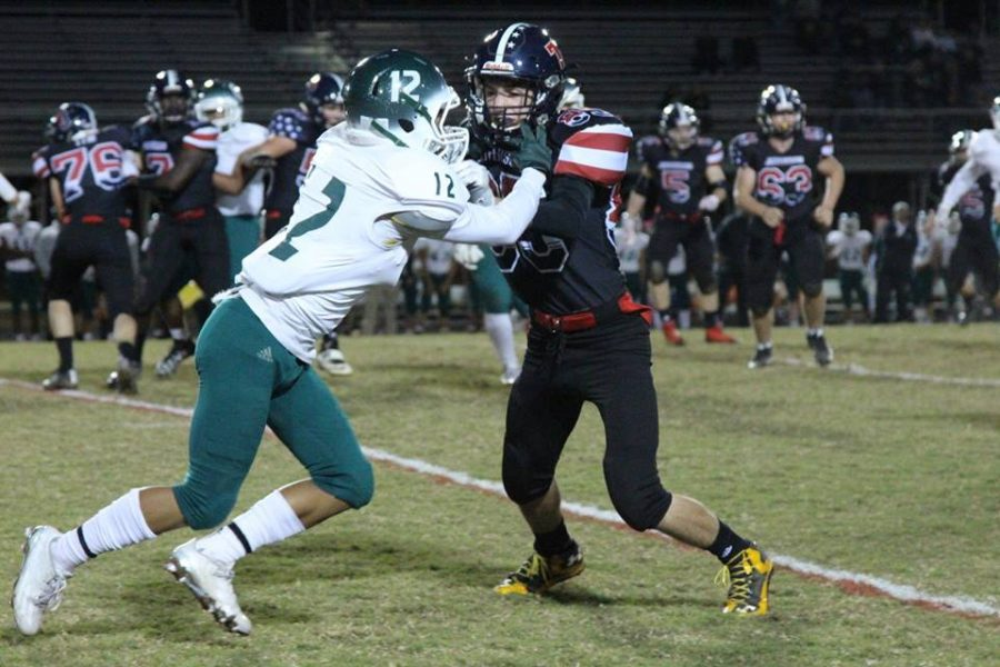 Wide receiver Kyle Gerner (right) blocks Falls Church defender Zayd Davis (left) as Jefferson runs the football