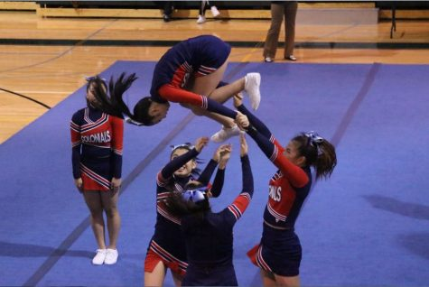 Rachel Lee backspots a flip at the cheerleading semifinals at Wakefield HS.