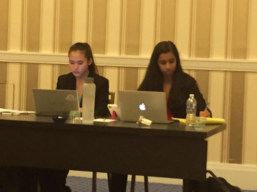 Boojala and Min review their research during the semifinal round of the Capitol Classic tournament on Oct. 24.