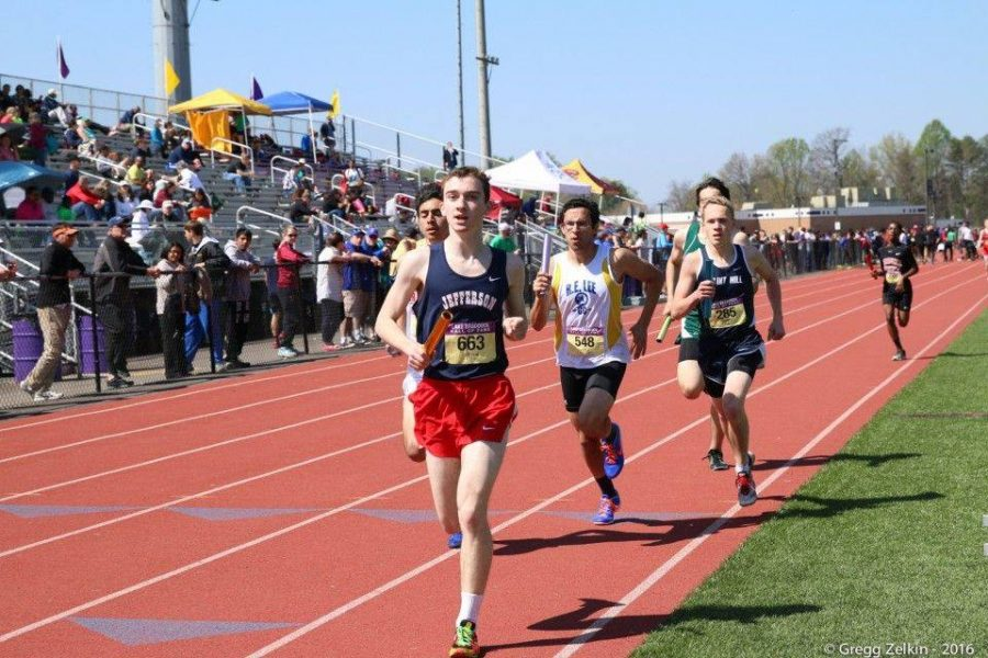 Junior Sean Clancy runs towards the finish line in a relay race.