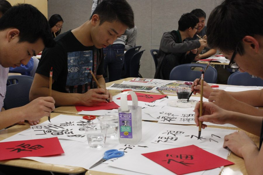Students+practice+writing+Chinese+characters+on+red+paper+using+Chinese+calligraphy+brushes+in+a+Chinese+Honor+Society+cultural+event.+The+event+took+place+on+Nov.+18+during+eighth+period.+
