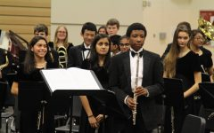 Turner Bumbary (right) proudly takes his bow with the rest of the Symphonic Band after a successful performance.