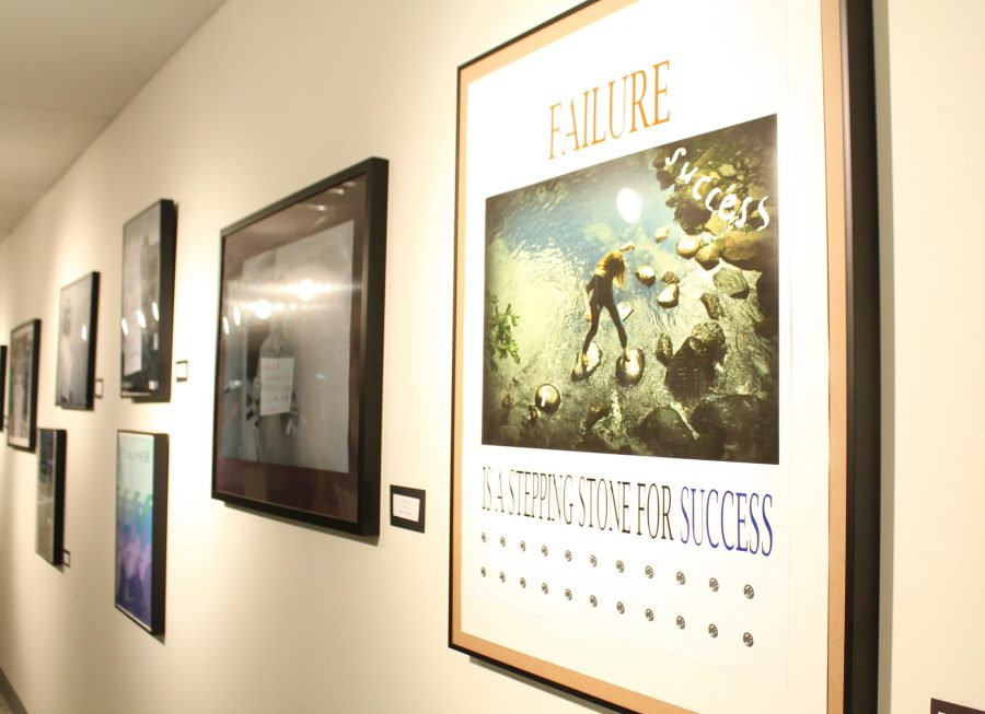 "Senior Audrey Huang's graphic art design, ""Failure"" hangs on the art gallery wall along with other submitted artworks."