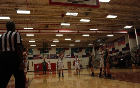 Freshmen Abby Kim takes 2 free throws in hopes to decrease the Jaguar's lead.