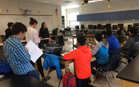 The Congressional Debate team listening and taking notes during a lunch meeting to their captain Victoria Bevard. The team was preparing for an upcoming tournament.