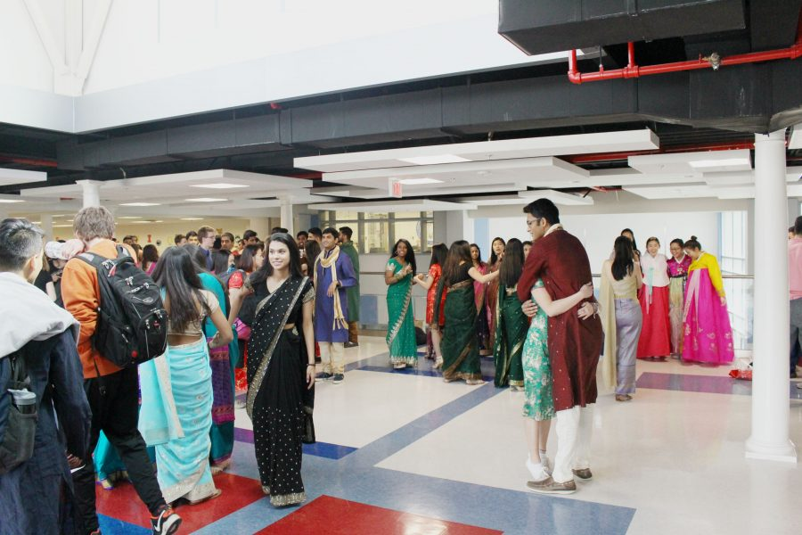 Students walk down the hall by the Freshman IBET commons on Red Day, in order to celebrate women's rights.