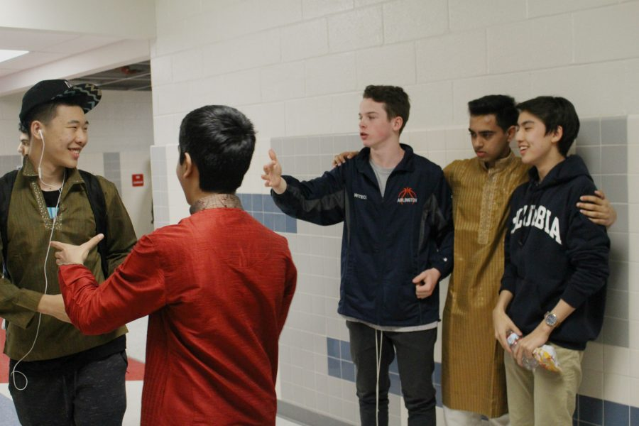 Several Freshmen try to organize a picture for International Day.