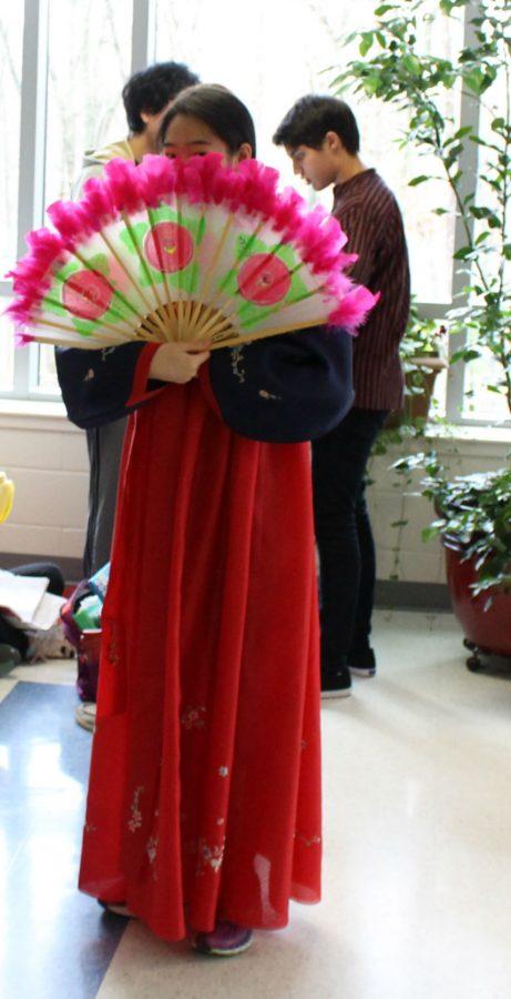 Junior Hannah Han fans her fan from Korean Culture Club for International Day.