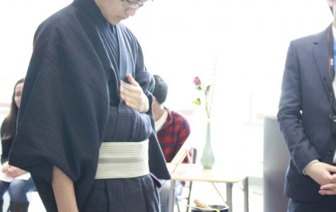Japanese exchange student Hodaka Ishibashi adjusts his clothing before performing a tea ceremony.