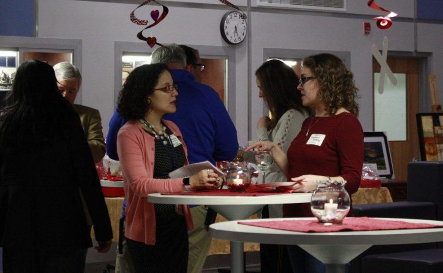 English teacher Suzette Henry converses with fellow English teacher Stephanie Glotfelty.