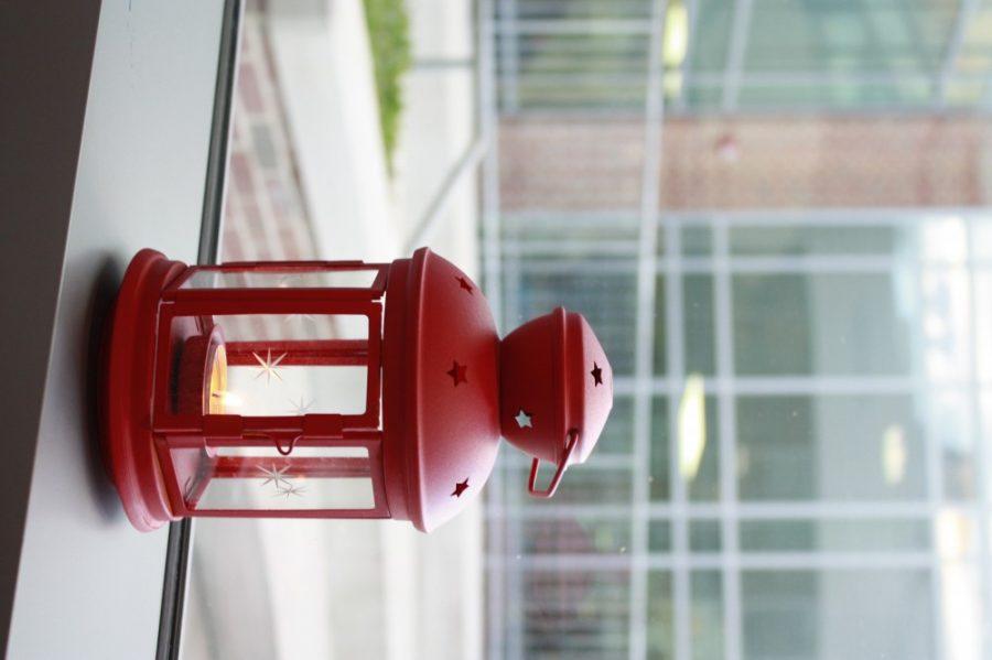 A lantern decorates a windowsill.