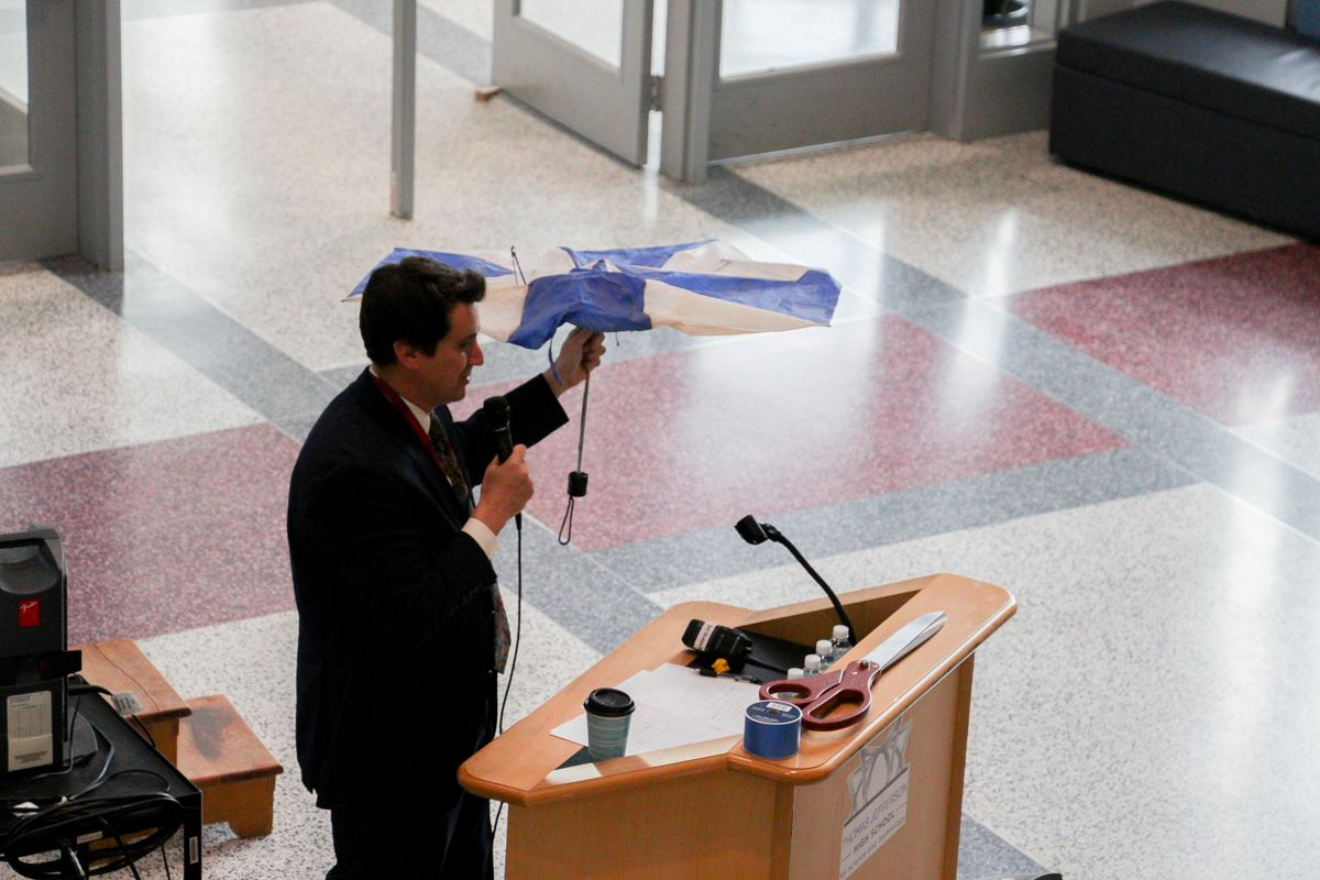 Photo courtesy of Angel Kim. Dr. Glazer holds up a broken umbrella during his speech.
