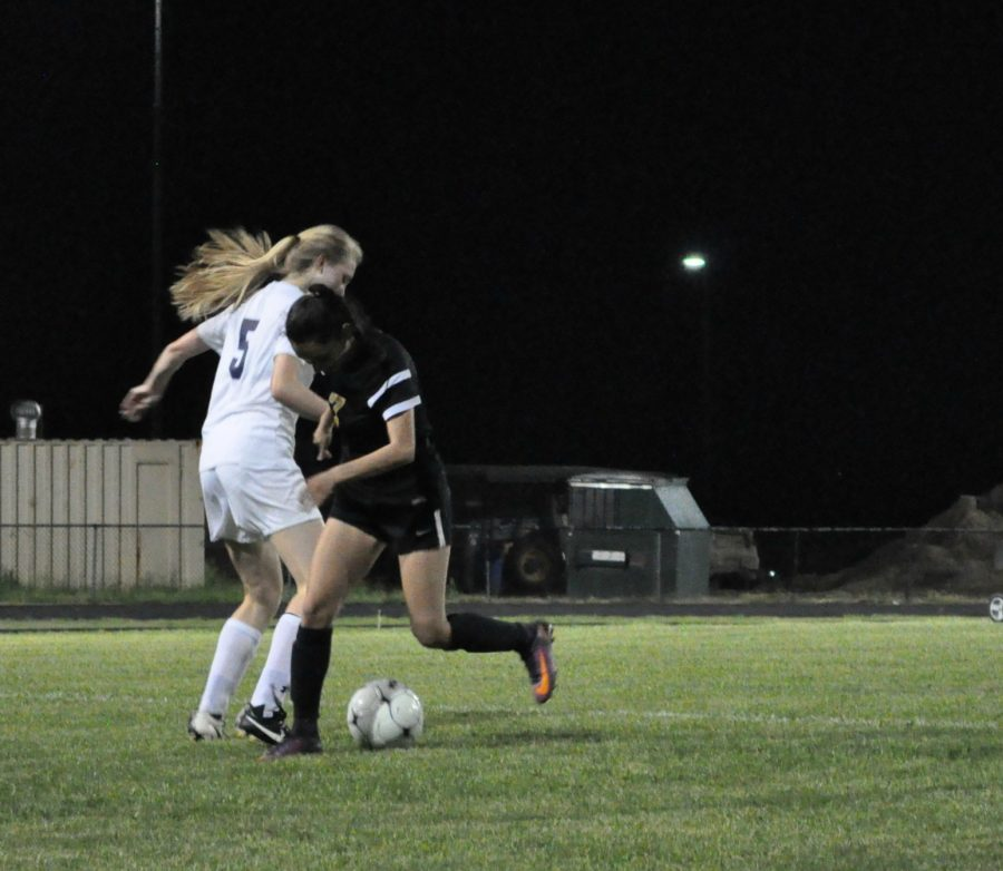 Senior Jodie Beaumont defends the ball against Falls Church.