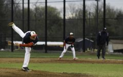Freshman Andrew Arnold pitches the ball during a game on Apr. 7.