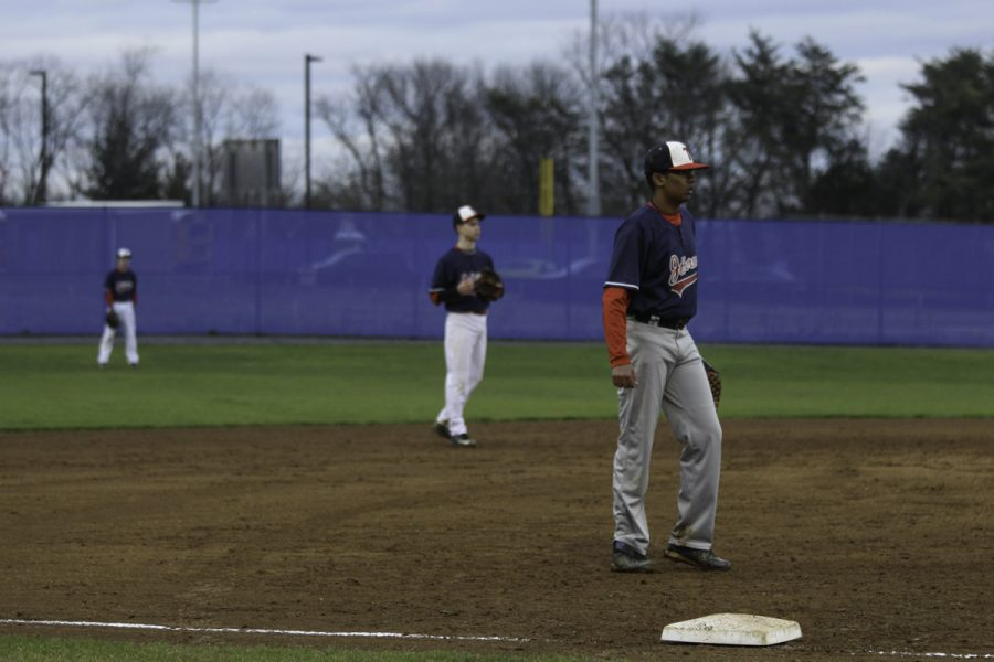 Players wait for the opposing batter to hit the ball.