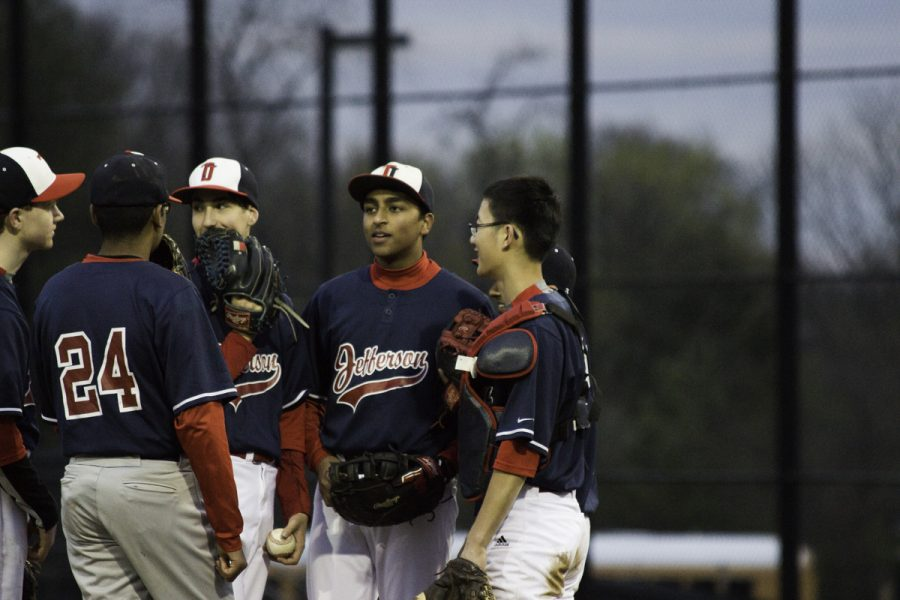 Players discuss game plans in between innings.