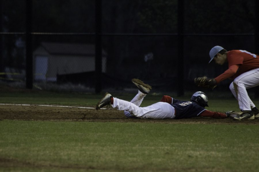 Freshman Andrew Arnold dives for the base.
