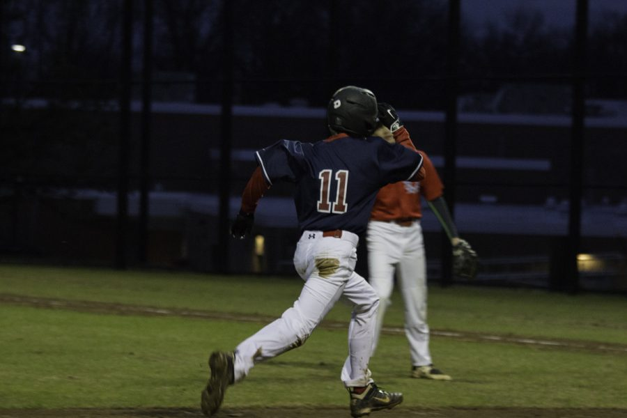 Freshman Charlie Dobson dashes toward home base.